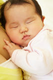 Vietnamese mother cuddling baby Stock Photo