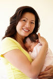 Vietnamese mother cuddling baby Stock Images