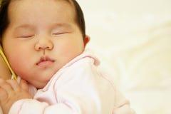 Vietnamese mother cuddling baby Stock Photos