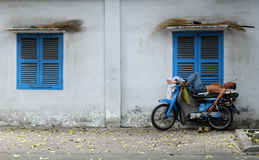 Vietnamese motorbike taxi driver sleeping on motorcycle Royalty Free Stock Image