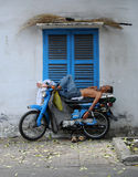 Vietnamese motorbike taxi driver sleeping on motorcycle Stock Photo
