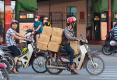 Vietnamese motorcyclist drives boxes Royalty Free Stock Images