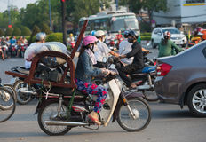 Vietnamese motorcyclist drives a chair Royalty Free Stock Photography