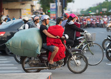 Vietnamese motorcyclist drives a lot of fabric Royalty Free Stock Image