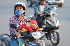 Vietnamese motorcyclist and her son Stock Photos