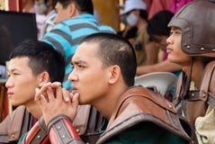 Vietnamese movie actors. HUE, VIETNAM - SEPTEMBER 3: Three unidentified movie actors in Thien Mu Temple in Hue, on September 3, 2010. Vietnam's film industry is Stock Image