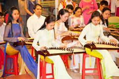 Vietnamese musicians performing muusic in Saigon, Vietnam. Royalty Free Stock Photography