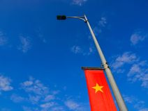 Vietnamese national flag. Against blue sky in summer day Stock Photos