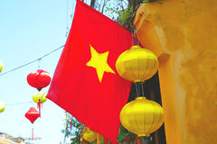 Vietnamese National Flag in Da Nang. Vietnam. Colorful silk lanterns in the foreground. Stock Photography