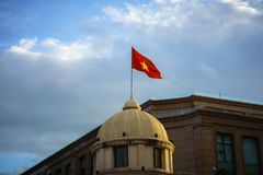 Vietnamese National Flag on top of a building.  Stock Photo