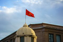 Vietnamese National Flag on top of a building.  Royalty Free Stock Images