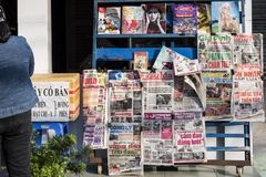Vietnamese newspapers and magazines on a stand in a street of Ho Chi Minh City in Vietnam. stock images