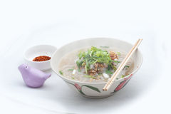 Vietnamese noodles. A kind of vietnamese noodles which contains of nodle lines bone pork fried garlic and onion as topic.To make more delicious use pepper and Royalty Free Stock Images