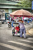 Vietnamese old women pushing a trolley Stock Photography