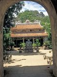 Vietnamese Pagoda. Red roofed Vietnamese style building (Linh Ung Pagoda) set in a paved courtyard, Marble Mountain, Vietnam Stock Photos