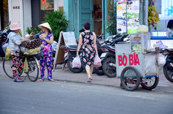 Vietnamese people with Bicycle Fruit and food Shop Royalty Free Stock Photo