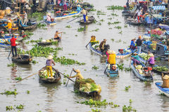 Vietnamese people on boat at Nga Nam floating market in the morning Royalty Free Stock Images