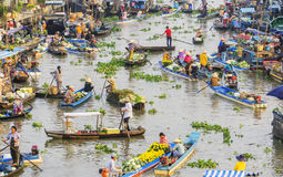 Vietnamese people on boat at Nga Nam floating market in the morning Stock Photos