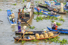 Vietnamese people on boat at Nga Nam floating market in the morning Stock Photo