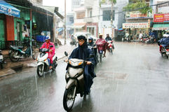 Vietnamese people, Ho Chi Minh city in rain Royalty Free Stock Image