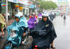Vietnamese people, Ho Chi Minh city in rain Stock Photos