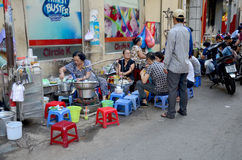 Vietnamese people with restaurant on street Royalty Free Stock Images