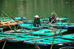 Vietnamese People sitting on Bamboo boat Royalty Free Stock Image