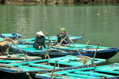 Vietnamese People sitting on Bamboo boat Royalty Free Stock Images