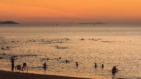 vietnamese people swim in sea bike on sand beach at sunrise stock footage