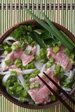 Vietnamese Pho Bo soup with beef rare closeup. top view Stock Photos