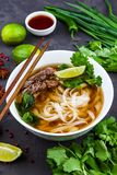 Vietnamese Pho Noodle Soup. Beef with Chilli, Basil, Rice Noodle. Pho Bo - Vietnamese fresh rice noodle soup with beef, herbs and chili. Vietnam`s national dish Stock Images