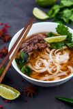 Vietnamese Pho Noodle Soup. Beef with Chilli, Basil, Rice Noodle. Pho Bo - Vietnamese fresh rice noodle soup with beef, herbs and chili. Vietnam`s national dish Stock Photos