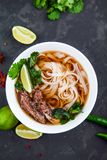 Vietnamese Pho Noodle Soup. Beef with Chilli, Basil, Rice Noodle. Pho Bo - Vietnamese fresh rice noodle soup with beef, herbs and chili. Vietnam`s national dish Stock Photo