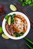 Vietnamese Pho Noodle Soup. Beef with Chilli, Basil, Rice Noodle. Pho Bo - Vietnamese fresh rice noodle soup with beef, herbs and chili. Vietnam`s national dish Stock Photography