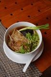 Vietnamese Pho noodle soup. Traditional Vietnamese Pho noodle soup with beef and fresh herbs Stock Photo