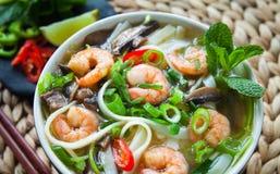 Vietnamese pho tom yum shrimp prawn soup stock photography