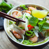 Vietnamese pho tom yum shrimp prawn soup royalty free stock photography