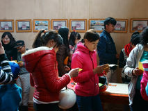 Vietnamese pick lucky present on Tet, traditional culture. DA LAT, VIET NAM- JAN 31: Group Vietnamese at pagoda on Tet,  people pick and read lucky present in Stock Photo