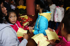 Vietnamese pick lucky present on Tet, traditional culture. DA LAT, VIET NAM- JAN 31: Group Vietnamese at pagoda on Tet,  people pick and read lucky present in Stock Photos