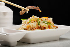 Vietnamese pilaf with beef in a chopsticks Royalty Free Stock Photo