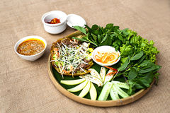 Vietnamese plain rice flan or banh khoai Hue with herbs and spec Stock Photography