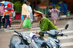 Vietnamese policeman at work Royalty Free Stock Images