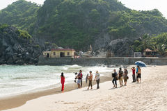 Vietnamese pop singer films music video. Cat Ba, Vietnam - May 12, 2014 - Vietnamese pop singer films music video at public beach at Cat Ba island Stock Image