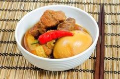 Vietnamese Pork Stew with Hard Boiled Egg. (Thit Kho Hot Vit) on bamboo tray Stock Image