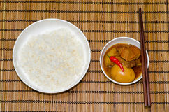 Vietnamese Pork Stew with Hard Boiled Egg. (Thit Kho Hot Vit) served with steamed rice, on bamboo tray Royalty Free Stock Photography