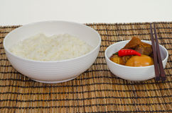 Vietnamese Pork Stew with Hard Boiled Egg. (Thit Kho Hot Vit) served with steamed rice, on bamboo tray Stock Photography