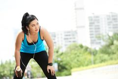 Exhausted girl. Vietnamese pretty young woman tired after jogging Royalty Free Stock Images