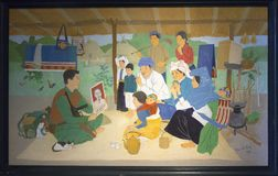 Vietnamese propaganda painting. With Ho Chi Minh showing soldier during political education of the peasants Stock Image