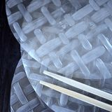 Vietnamese rice paper for spring rolls and bamboo sticks royalty free stock images