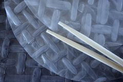 Vietnamese rice paper for spring rolls and bamboo sticks stock photography